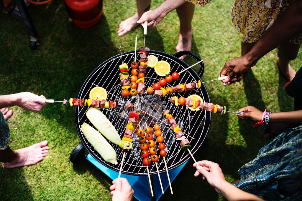 View from above of people grilling skewers